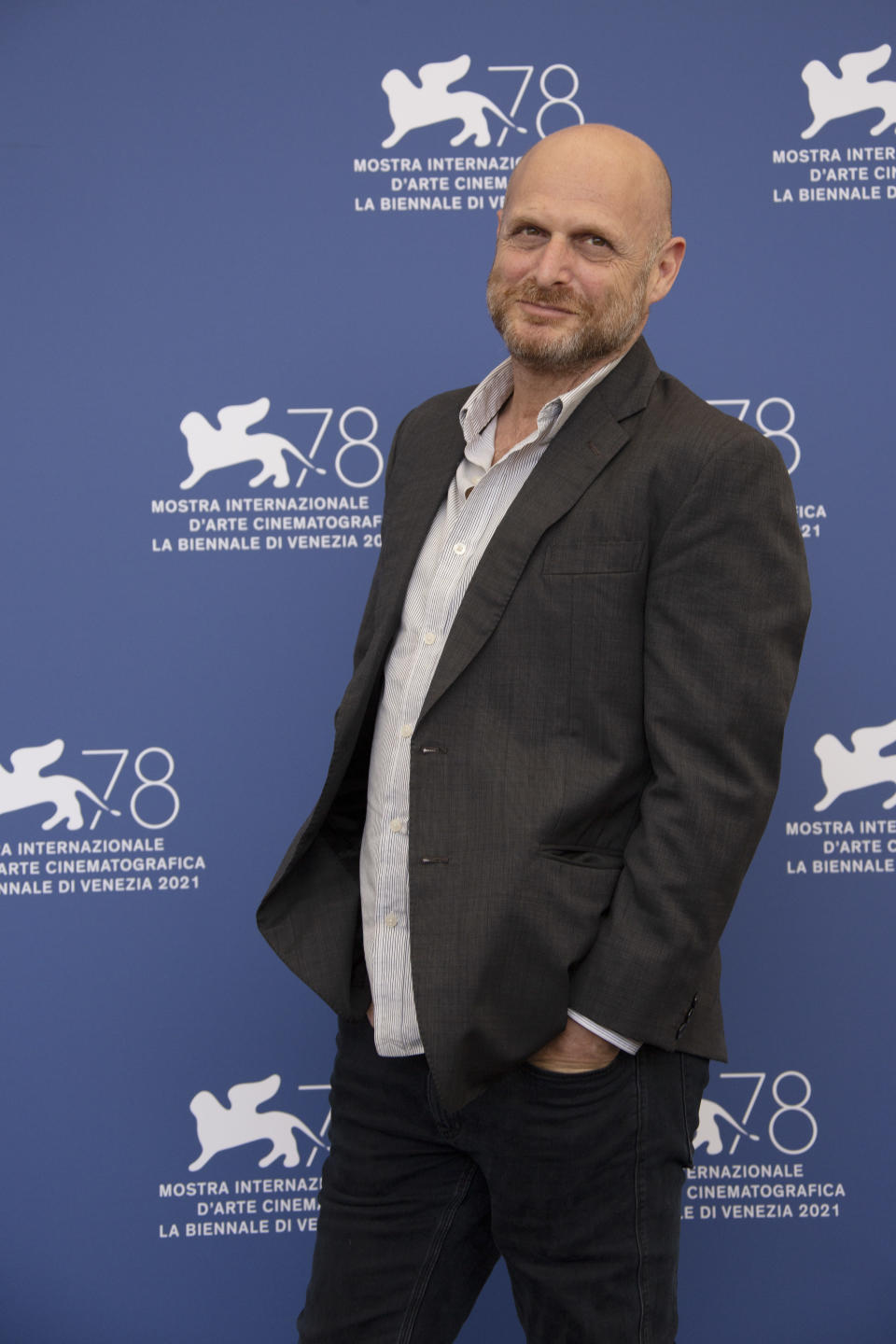 Hagai Levi poses for photographers at the photo call for the film 'Scenes of a Marriage' during the 78th edition of the Venice Film Festival in Venice, Italy, Saturday, Sep, 4, 2021. (Photo by Joel C Ryan/Invision/AP)