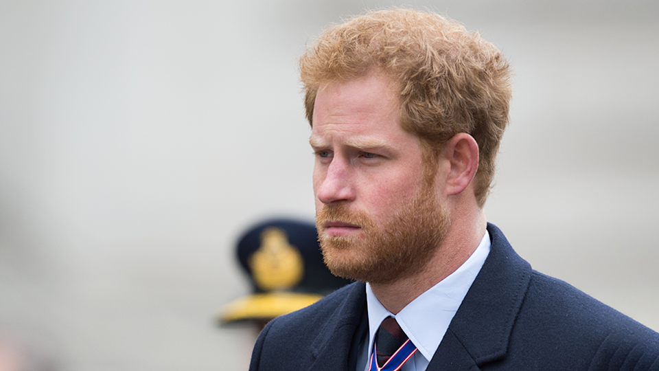 {Prince Harry appears sad during Remembrance Day Service
