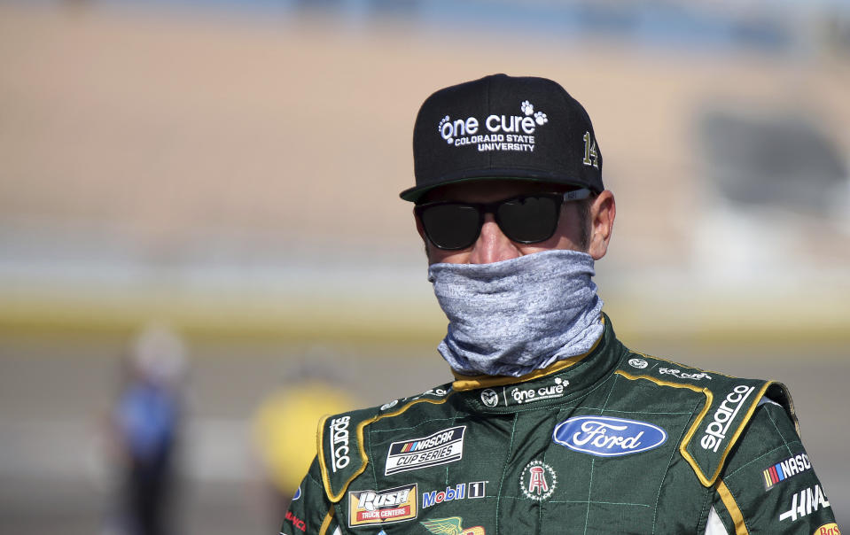 Clint Bowyer walks to his race car before a NASCAR Cup Series auto race Sunday, Sept. 27, 2020, in Las Vegas. (AP Photo/Isaac Brekken)