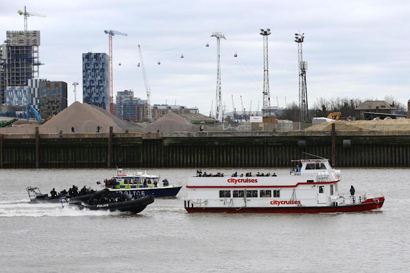 Police officers taking part in a multi-agency exercise to test their response to a marauding terrorist attack on a boat in London (PA)
