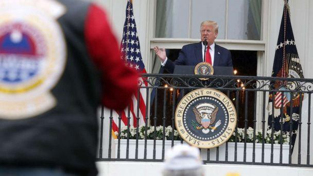 PHOTO: President Donald Trump speaks from the Truman Balcony during a ceremony to honor veterans at the White House May 22, 2020, in Washington. (Alex Wong/Getty Images)