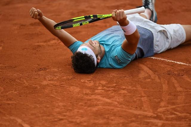 Breakthrough: Italy's Marco Cecchinato celebrates after victory against David Goffin in the fourth round (AFP Photo/CHRISTOPHE ARCHAMBAULT )