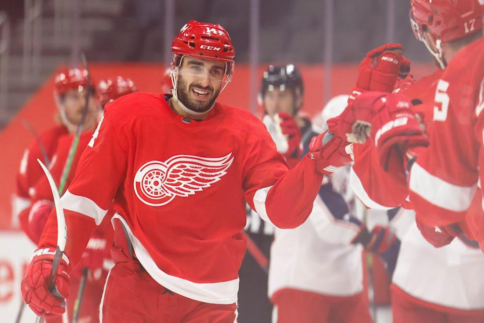 Detroit Red Wings center Robby Fabbri (14) is congratulated by teammates after scoring in the first period against the Columbus Blue Jackets on March 27, 2021, at Little Caesars Arena.