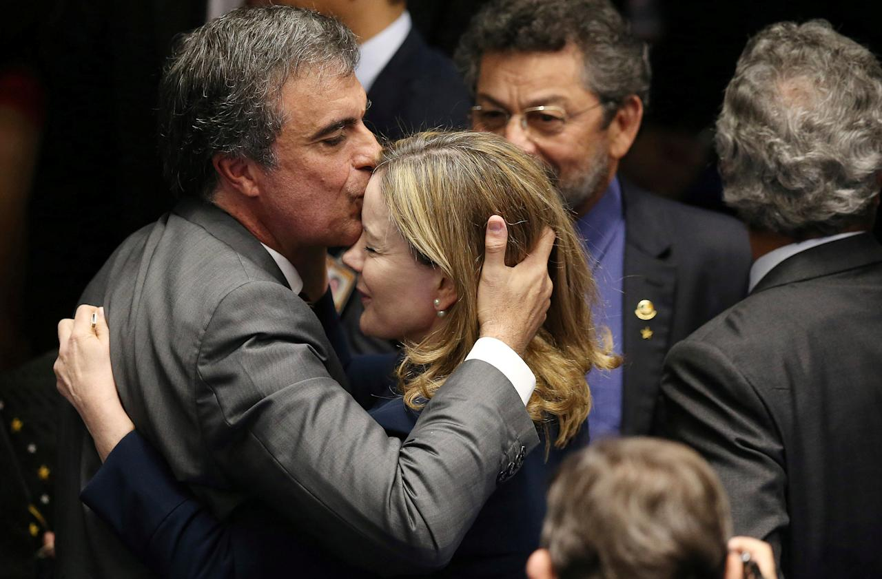 Suspended Brazilian President Dilma Rousseff's attorney in the impeachment proceedings, Jose Eduardo Cardozo (L), kisses senator Gleisi Hoffmann during the final session of debate and voting on Rousseff's impeachment trial in Brasilia, Brazil, August 30, 2016. REUTERS/Adriano Machado