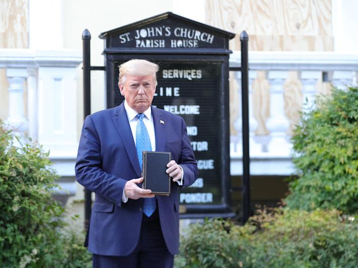 US president Donald Trump holds up a Bible as he stands in front of St. John's Episcopal Church across from the White House after walking there for a photo opportunity during ongoing protests over racial inequality in the wake of the death of George Floyd while in Minneapolis police custody, at the White House in Washington on 1 June 2020 ((Reuters))