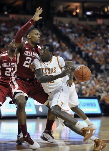 Texas guard Myck Kabongo, right, goes to the basket against Oklahoma forward Romero Osby, left, during the first half of an NCAA college basketball game Wednesday, Feb. 29, 2012, in Austin, Texas. (AP Photo/Michael Thomas)