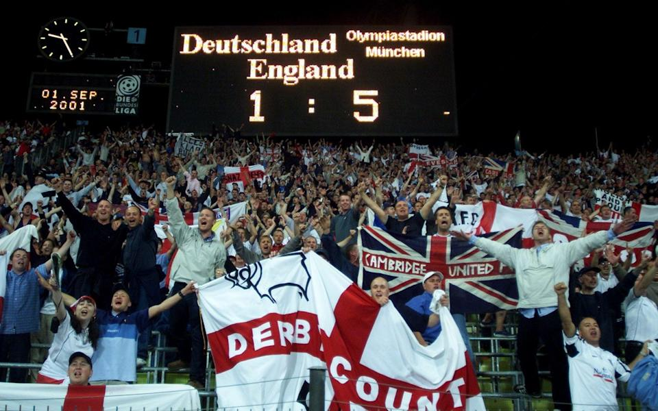 England soccer fans cheer and sing after a World Cup Qualifying match England against Germany in Munich Olympic Stadium September 1, 2001 - REUTERS