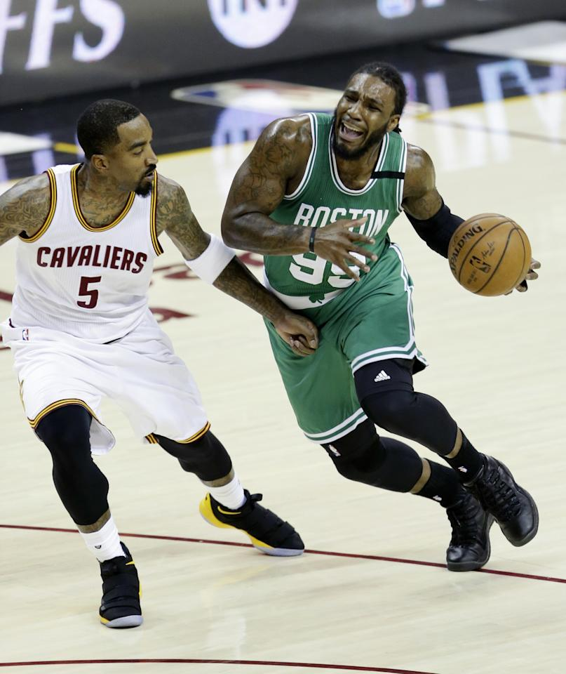 <p>Boston Celtics' Jae Crowder (99) drives on Cleveland Cavaliers' J.R. Smith (5) during the first half of Game 4 of the NBA basketball Eastern Conference finals, Tuesday, May 23, 2017, in Cleveland. (AP Photo/Tony Dejak) </p>