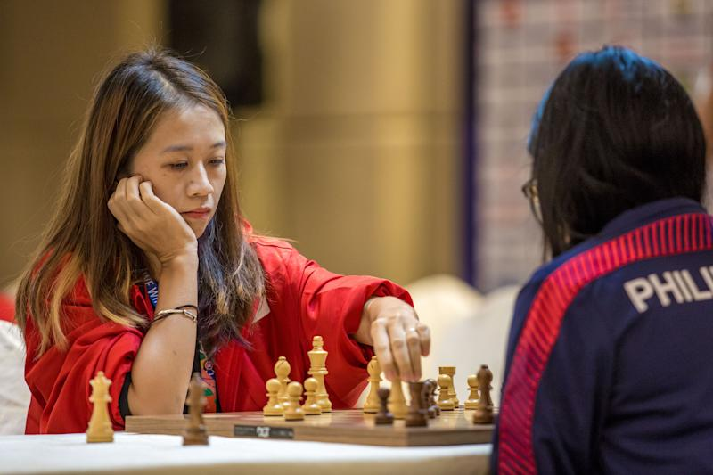 Singapore chess player Gong Qianyun playing against Philippines' Shania Mae Mendoza en route to her SEA Games gold medal. (PHOTO: Sport Singapore/Dyan Tjhia)
