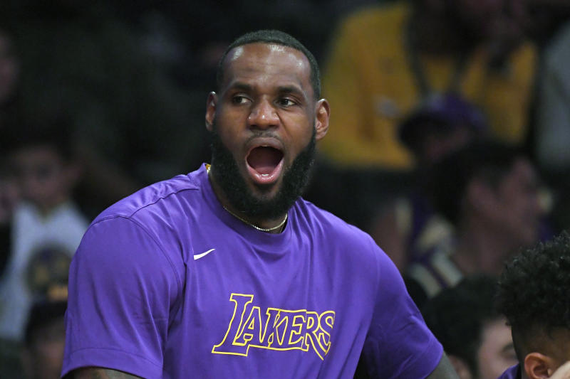 Los Angeles Lakers forward LeBron James yawns as he sits on the bench during the second half of a preseason NBA basketball game against the Golden State Warriors, Monday, Oct. 14, 2019, in Los Angeles. The Lakers won 104-98. (AP Photo/Mark J. Terrill)