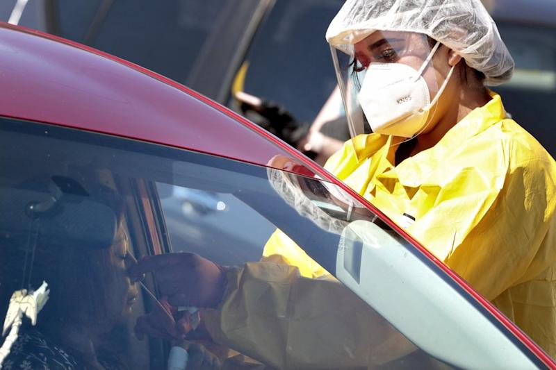 People get tested for COVID-19 at a drive through testing site hosted by the Puente Movement migrant justice organisation in Phoenix. Source: AP