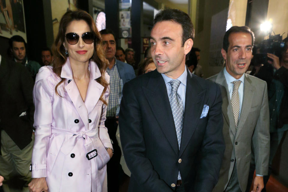 MADRID, SPAIN - MAY 29:  Spanish bullfighter Enrique Ponce (R) and wife Paloma Cuevas  (L) attend 'Del Ruedo a la Pasarela' Exhibition on May 29, 2014 in Madrid, Spain.   (Photo by Pablo Cuadra/Getty Images)