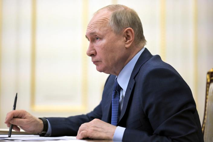 Russian President Vladimir Putin listens during a cabinet meeting via video conference in Moscow, Russia, Thursday, April 8, 2021. (Alexei Druzhinin, Sputnik, Kremlin Pool Photo via AP)