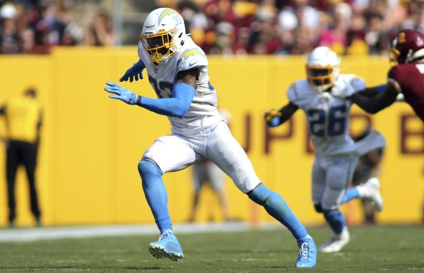 Los Angeles Chargers free safety Derwin James (33) runs during an NFL football game against the Washington Football Team, Sunday, Sept. 12, 2021 in Landover, Md. (AP Photo/Daniel Kucin Jr.)