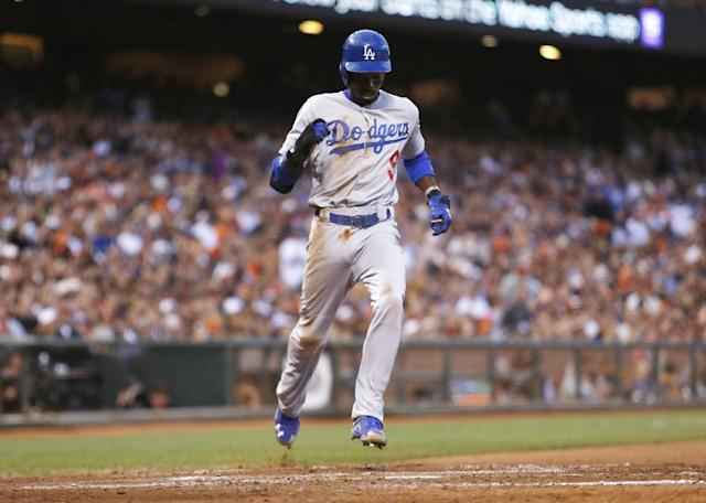 Los Angeles Dodgers' Dee Gordon scores during the seventh inning of a baseball game against the San Francisco Giants, Saturday, July 26, 2014, in San Francisco. (AP Photo/Beck Diefenbach)