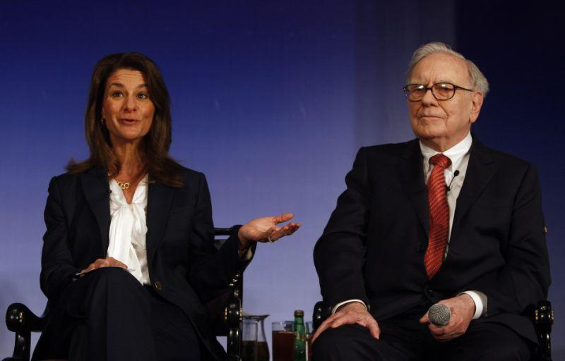 Melinda Gates, left, wife of Microsoft founder and billionaire philanthropist Bill Gates, speaks during a press conference as Billionaire investor Warren Buffett looks on in New Delhi, India, Thursday, March 24, 2011. Billionaire philanthropists Bill Gates and Buffett urged India's tycoons on Thursday to give up some of their newfound wealth to help the country's hundreds of millions of impoverished people. (AP Photo/ Mustafa Quraishi)