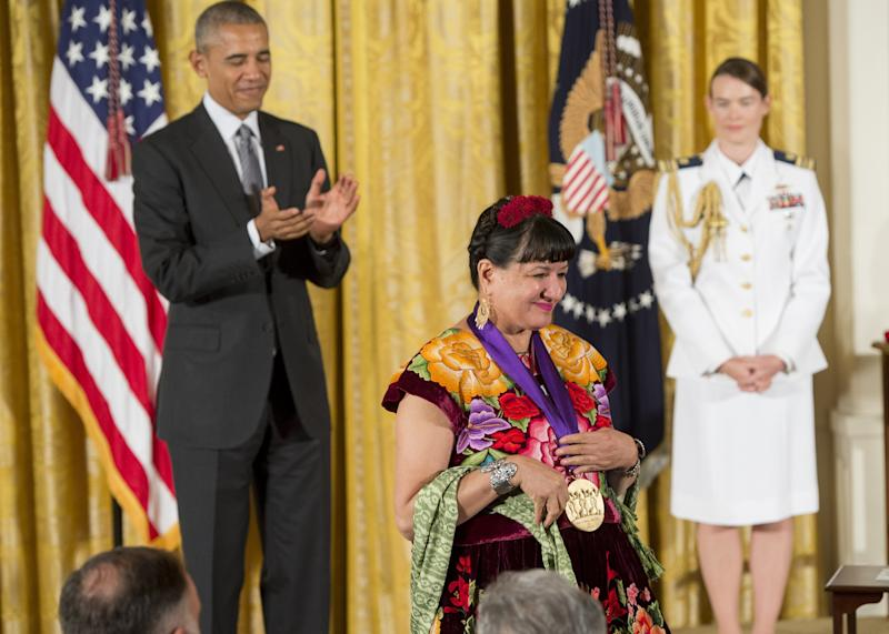 Sandra Cisneros is presented with the 2015 National Medal of Arts.  (SAUL LOEB via Getty Images)