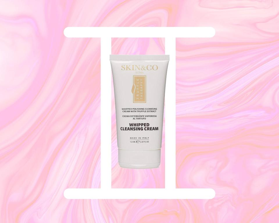 Skin & Co Truffle Therapy Whipped Cleansing Cream on a designed background with the Gemini symbol
