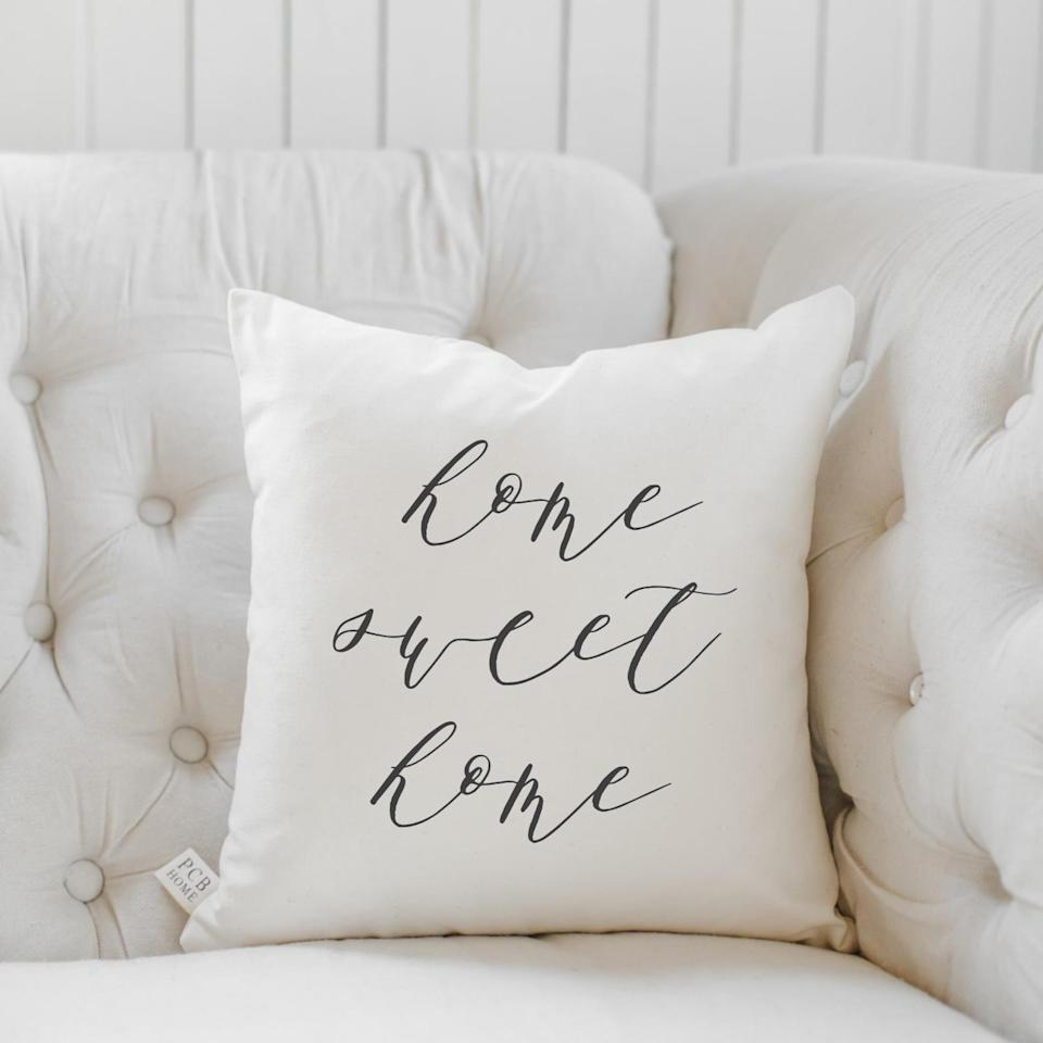 <p>This <span>PCB Home Throw Pillow</span> ($20-$40) will nicely add to their farmhouse interior-design style.</p>