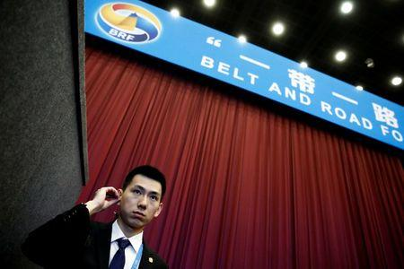 FILE PHOTO - A security guard stands at the entrance to the opening ceremony of the Belt and Road Forum in Beijing