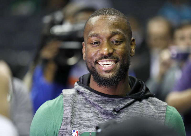 Kemba Walker received a rousing ovation in Charlotte on Thursday. (Bob Leverone/AP)