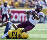Virginia Tech wide receiver Tayvion Robinson (9) is tackled by West Virginia safety Sean Mahone (29) during the first half of an NCAA college football game in Morgantown, W.Va., Saturday, Sept. 18, 2021. (AP Photo/William Wotring)