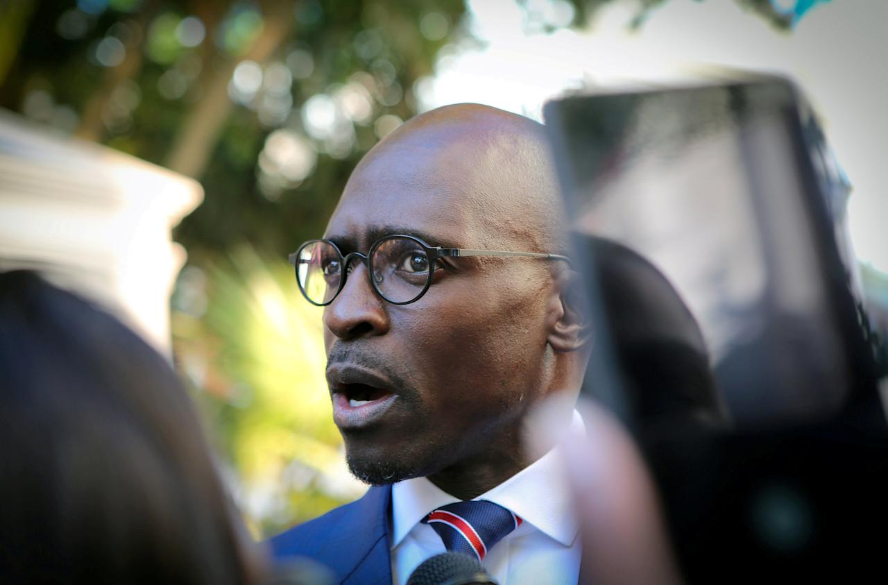 FILE PHOTO: Finance Minister Malusi Gigaba speaks to members of the media at Parliament before the State of the Nation Address by South African president Cyril Ramaphosa in Cape Town, February 16, 2018. REUTERS/Sumaya Hisham/File Photo