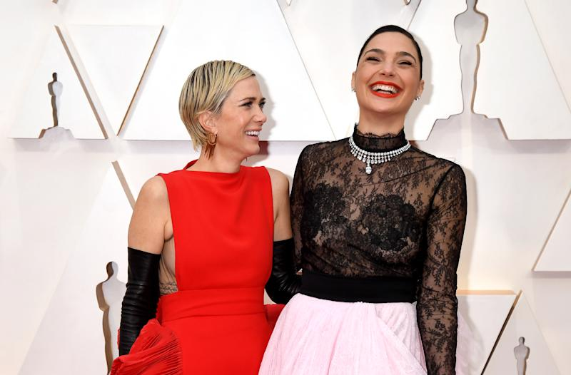 Kristen Wiig and Gal Gadot attend the 92nd Annual Academy Awards at Hollywood and Highland on February 09, 2020 in Hollywood, California.