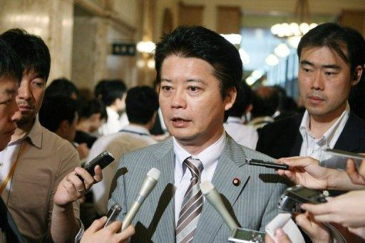 Japan' s Foreign Minister Koichiro Gemba (C) speaks to reporters at parliament in Tokyo, on August 10. Gemba said on Saturday that Tokyo was considering asking the International Court of Justice to settle a bitter row with South Korea over a disputed island group, a day after S.Korean President Lee Myung-Bak made a surprise visit to the islands, known as Takeshima in Japanese and Dokdo in Korean