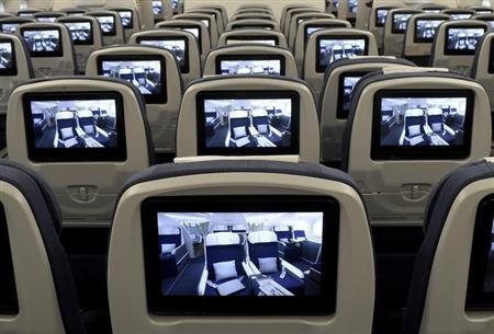 TV screens, installed on board of an Airbus A350 XWB flight-test aircraft are pictured during a media-day at the German headquarters of aircraft company Airbus in Hamburg-Finkenwerder