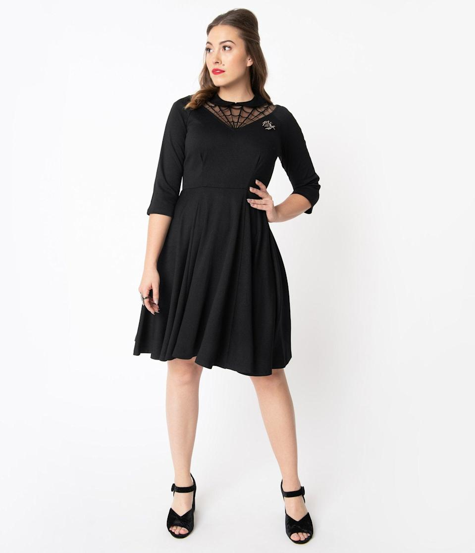<p>You'll look bewitching in this <span>Unique Vintage Black Spiderweb Endora Fit and Flare Dress</span> ($88).</p>