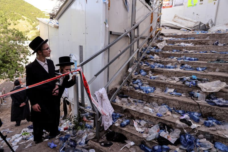 FILE PHOTO: Ultra Orthodox Jews look at stairs with waste on it in Mount Meron