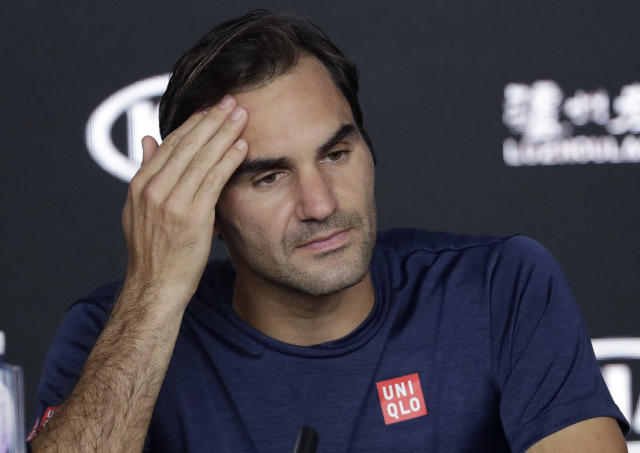 Switzerland's Roger Federer answers questions at a press conference following his fourth round loss to Greece's Stefanos Tsitsipas at the Australian Open tennis championships in Melbourne, Australia, Sunday, Jan. 20, 2019. (AP Photo/Aaron Favila)