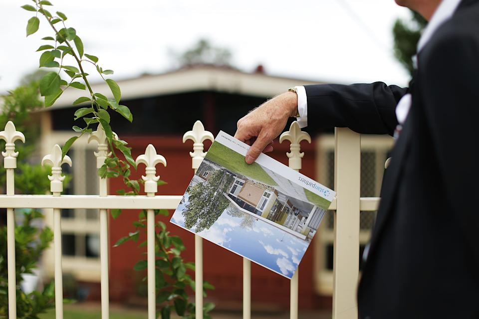 BLACKTOWN, AUSTRALIA - FEBRUARY 14:  A prospective buyer looks at a property before the home auction for a four-bedroom house at 230 Blacktown Road on February 14, 2015 in Blacktown, Australia. The Blacktown home sold for AUD$565,000 at auction today, smashing the reserve set at AUD$1. The Sydney home auction clearance rate is expected to remain high following the Reserve Bank's interest rate cut to 2.25 per cent last week.  (Photo by Mark Metcalfe/Getty Images)