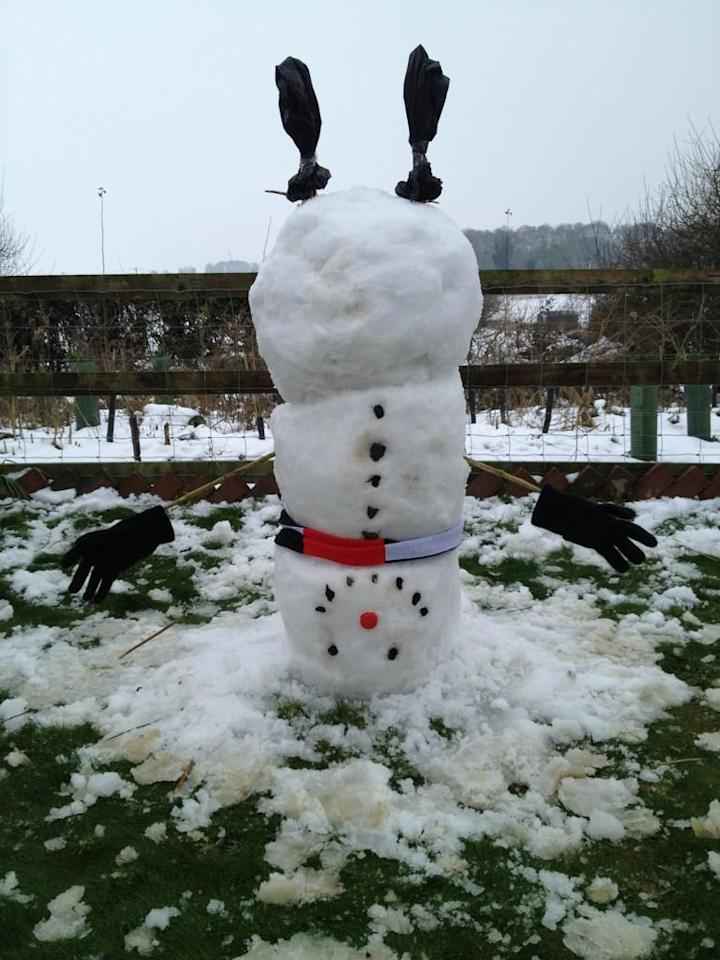 This unusual snowman was built upside down - but he still has his scarf, gloves and socks to keep him warm (@Andy_charman)
