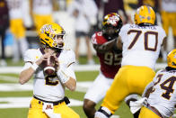 Minnesota quarterback Tanner Morgan looks to pass against Maryland during the first half of an NCAA college football game, Friday, Oct. 30, 2020, in College Park, Md. (AP Photo/Julio Cortez)