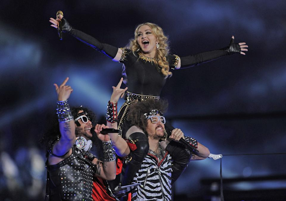 Singer Madonna (top) performs with Redfoo and Sky Blu (L) of LMFAO during the NFL Super Bowl XLVI game halftime show on February 5, 2012 at Lucas Oil Stadium in Indianapolis, Indiana. (TIMOTHY A. CLARY/AFP via Getty Images)