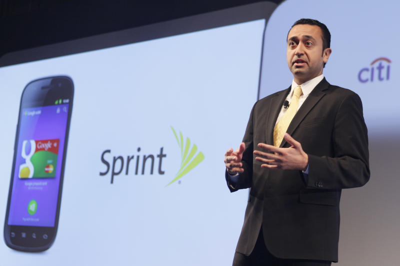 """Sprint Vice President of Product Development Fared Adib speaks during a news conference, Thursday, May 26, 2011 in New York.  Google wants the smartphone to be the wallet of the future, a container for digital credit cards, coupons, receipts and loyalty cards that can be """"tapped"""" to terminals in stores.  (AP Photo/Mary Altaffer)"""