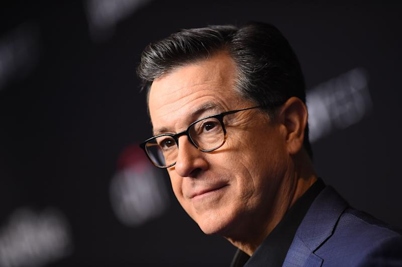 """US comedian Stephen Colbert arrives at the PaleyFest presentation of """"An evening with Stephen Colbert"""" at the Dolby theatre on March 16, 2019 in Hollywood, California. (Photo by VALERIE MACON / AFP)VALERIE MACON/AFP/Getty Images ORIG FILE ID: AFP_1EQ2QQ"""
