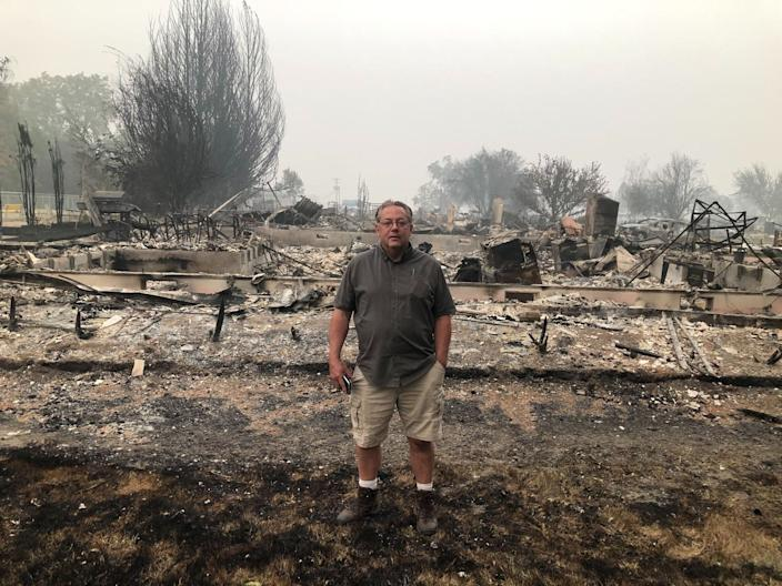 """Phoenix, Ore., Mayor Chris Luz stands amid the remains of homes in his town of 4,500. <span class=""""copyright"""">(Molly Hennessy-Fiske/Los Angeles Times)</span>"""
