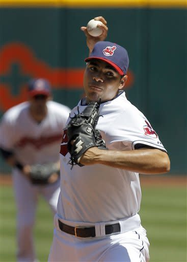 Cleveland Indians starting pitcher Jeanmar Gomez throws in the first inning of a baseball game against the Kansas City Royals in Cleveland on Wednesday, May 30, 2012. (AP Photo/Amy Sancetta)