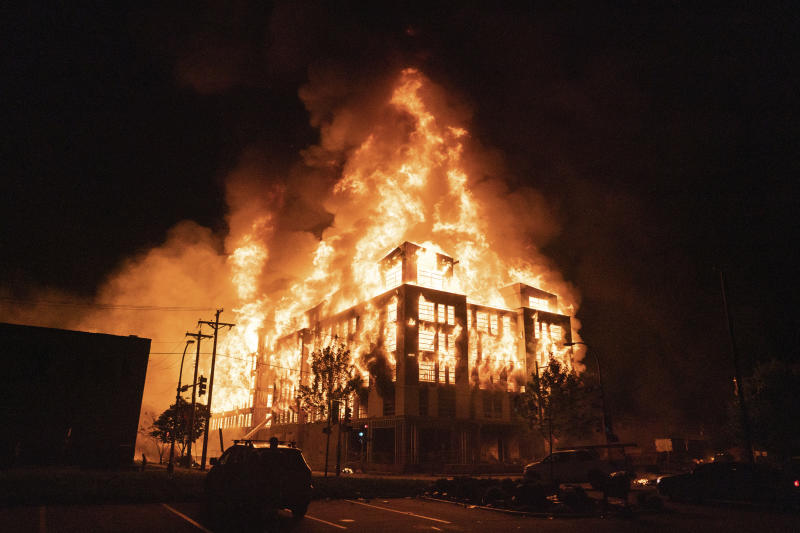 A multi-story affordable housing complex under construction near the Third Precinct, burns on Wednesday, May 27, 2020 in Minneapolis, Minn. Protests were sparked by the death of George Floyd at the hands of a Minneapolis Police officer Monday. (Mark Vancleave/Star Tribune via AP)