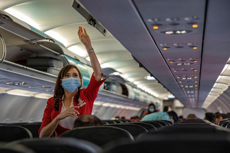 INCHEON, SOUTH KOREA - MARCH 10: A flight attendant is seen wearing a facemask aboard an AirAsia flight bound for Manila, Philippines, at Incheon International Airport on March 10, 2020 in Incheon, South Korea. According to the Korea Centers for Disease Control and Prevention, 131 new cases have been reported, with the death toll rising to 54. The total number of infections in the nation tallies at 7,513. (Photo by Ezra Acayan/Getty Images) (Photo: Ezra Acayan via Getty Images)