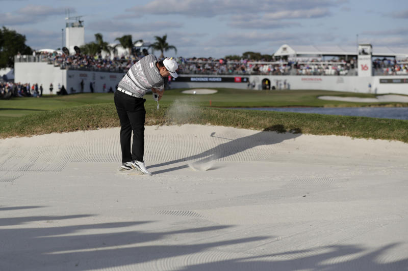 Sungjae Im of South Korea hits from a bunker on the 16th hole during the final round of the Honda Classic golf tournament, Sunday, March 1, 2020, in Palm Beach Gardens, Fla. (AP Photo/Lynne Sladky)