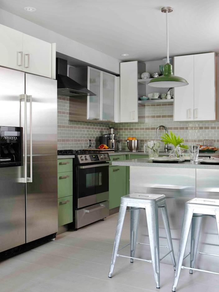 <p>Multiple stripes in a complementary color give this sweet kitchen backsplash a one-of-a-kind look with charming appeal. By keeping the floor and upper cabinets light, the lightly colored backsplash makes a bold statement in the space. </p>