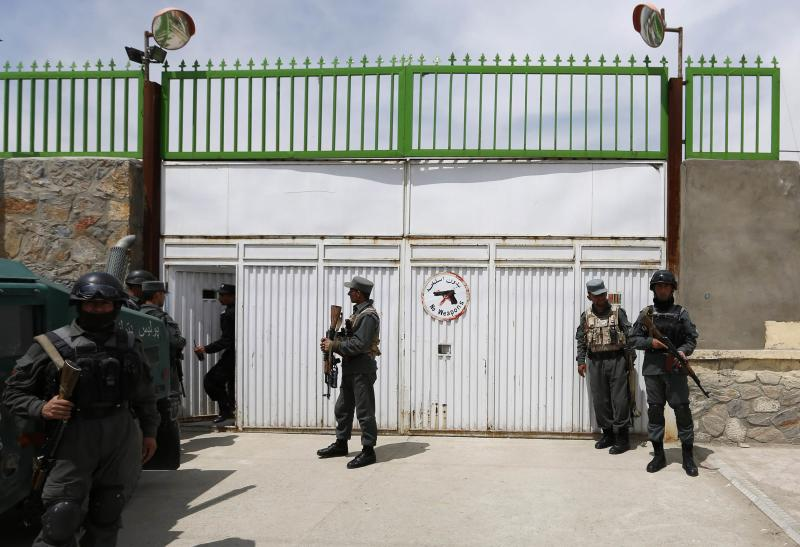 Afghan policemen stand at the gate of Cure Hospital after three foreigners were killed in Kabul April 24, 2014. Three foreigners were killed on Thursday when a security guard opened fire at Cure Hospital, an international hospital, in the Afghan capital,�Kabul, security sources said, in the latest of a series of attacks against foreign civilians. REUTERS/Mohammad Ismail (AFGHANISTAN - Tags: CIVIL UNREST HEALTH)