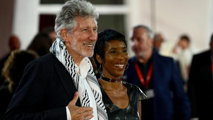"""Roger Waters and a guest walk the red carpet ahead of the 'Roger Waters Us + Them' screening during the 76th Venice Film Festival at Sala Darsena on September 06, 2019 in Venice, Italy. <span class=""""copyright"""">Photo by Matteo Chinellato/NurPhoto via Getty Images</span>"""