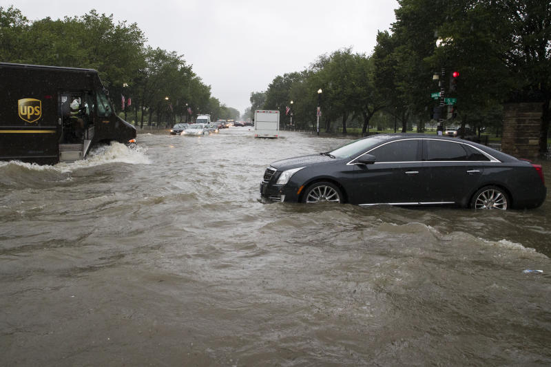 Heavy rainfall flooded the intersection of 15th Street and Constitution Ave., NW stalling cars in the street, Monday, July 8, 2019, in Washington. (Photo: Alex Brandon/AP)