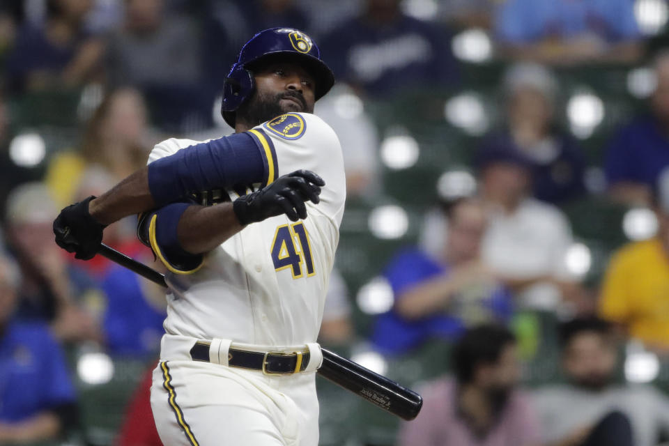 Milwaukee Brewers' Jackie Bradley Jr. swings and misses a pitch during the eighth inning of a baseball game against the St. Louis Cardinals, Monday, Sept. 20, 2021, in Milwaukee. (AP Photo/Aaron Gash)