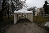 """In this photo taken Wednesday, Jan. 6, 2021, an empty tent set up in front of Institute of Virology, Vaccines and Sera """"Torlak"""" in Belgrade, Serbia. Across the Balkans and the rest of the nations in the southeastern corner of Europe, a vaccination campaign against the coronavirus is overshadowed by heated political debates or conspiracy theories that threaten to thwart the process. In countries like the Czech Republic, Serbia, Bosnia, Romania and Bulgaria, skeptics have ranged from former presidents to top athletes and doctors. Nations that once routinely went through mass inoculations under Communist leaders are deeply split over whether to take the vaccines at all. (AP Photo/Darko Vojinovic)"""